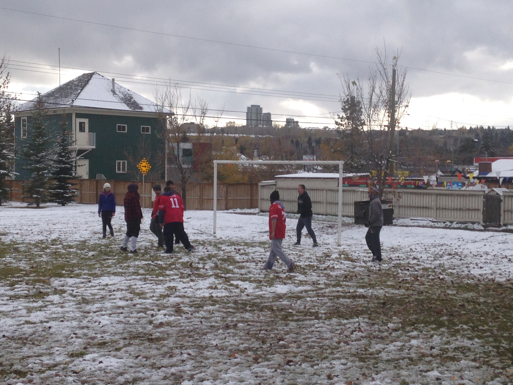 Grand Trunk Park annual Turkey Bowl happens on Thanksgiving Day snow or shine! The snowman was in the middle of the field, but that didn't seem to bother anyone.