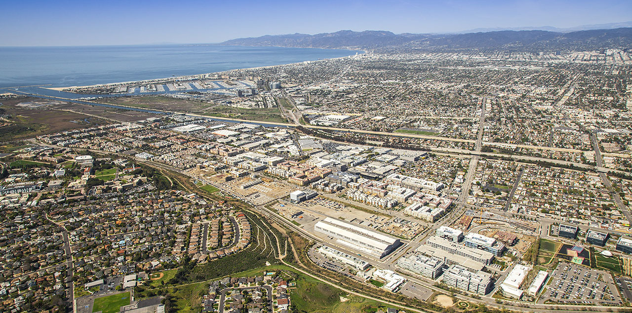 LA doesn't have the amount of vacant land that Calgary does, but one interesting large-scale land development is Playa Vista, developed on the former site of Howard Hughes Airport (the project was bought by Calgary's Brookfield Residential). A master planned community, it has been developing over time since 2002, demonstrating that a long-term commitment and phased build-out can create exceptional long-term value (as opposed to trying to build the entire community as quickly as possible, and claiming there is no market for density). This allows the developer to build at higher densities than a shorter build out would allow (since the market would not be there for higher densities). It's organized into blocks, with an emphasis on a high quality public realm, with one-third of the area set aside as a wetland preserve. It has a range of architecture, from traditional to contemporary and a mix of apartments, single family, retail, and office -- a genuine complete community. It's also an ethnically diverse community. Its amenities has attracted several tech companies to locate there (Microsoft, Facebook, Electronic Arts, Belkin). This is the kind of complete community Calgary's new communities should aspire to.