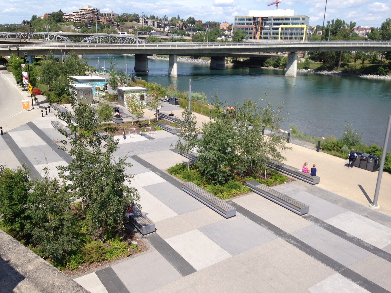 East Village's Riverwalk with the Langevin bridge, 4th, 5th and LRT flyovers in the background.