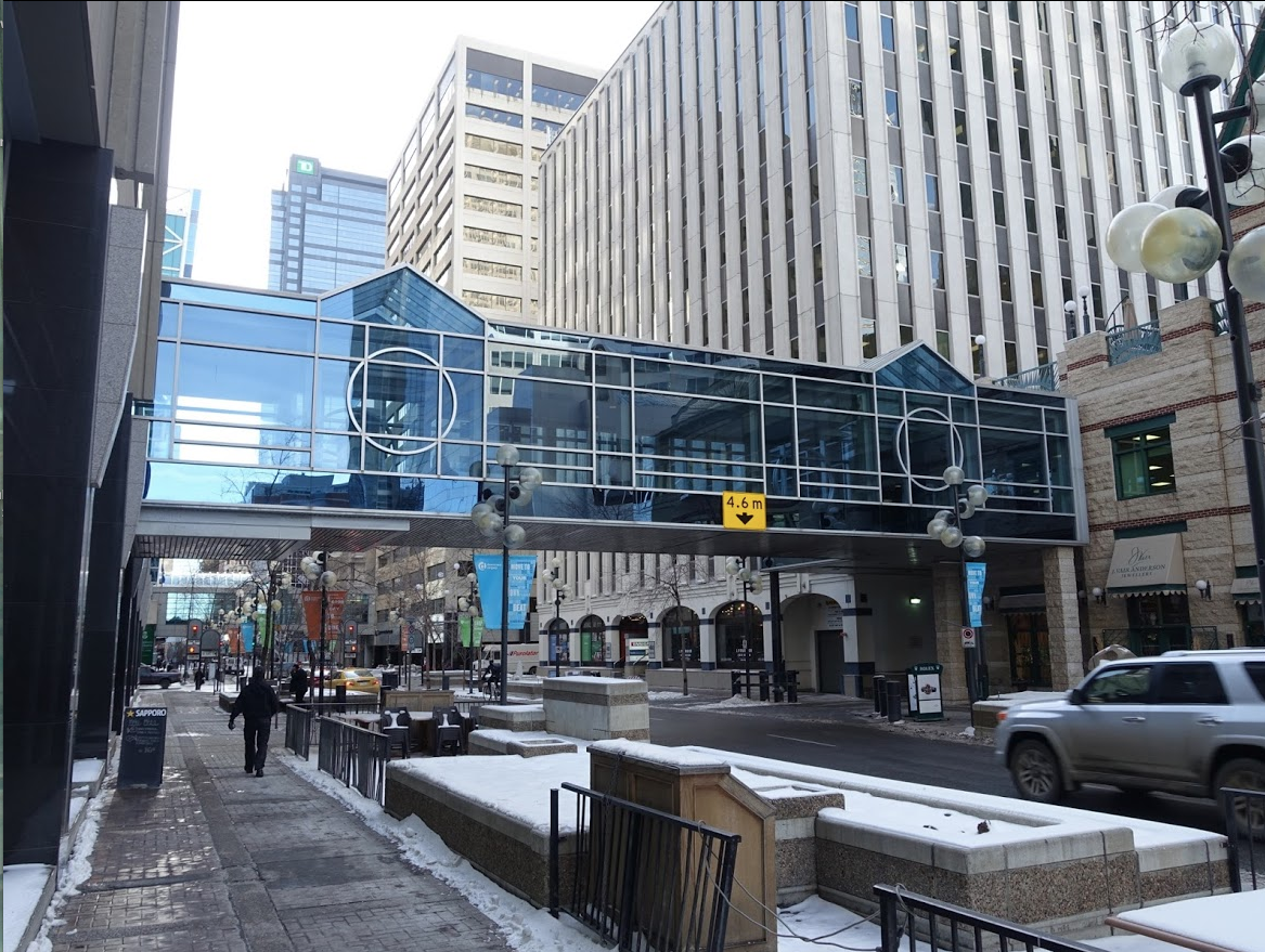 Calgary's +15 walkway allows downtown workers to explore downtown without having to put on their coats and also without having to negotiate slippery streets and cars.  Planners don't like them as they say they destroy the street vitality.  Public loves them.  My observation is that public uses them when climate is harsh but once the weather is nice (winter or summer) people would rather be outside.  It is the best of both worlds.