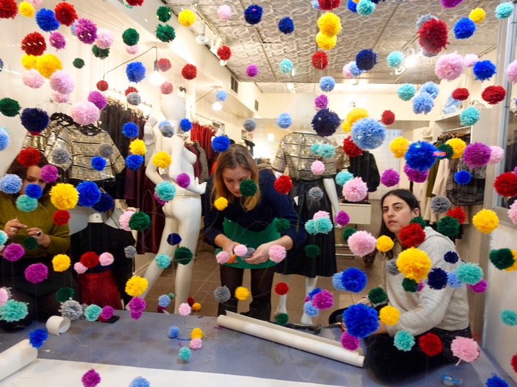 "Found these ""pom pom"" ladies creating a playful window display along Boulevard St. Laurent."