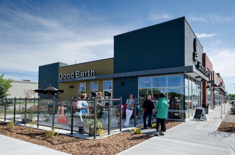 Good Earth Cafe and patio part of a car-oriented big box power centre, is also walkable from several major condo complexes a block away.