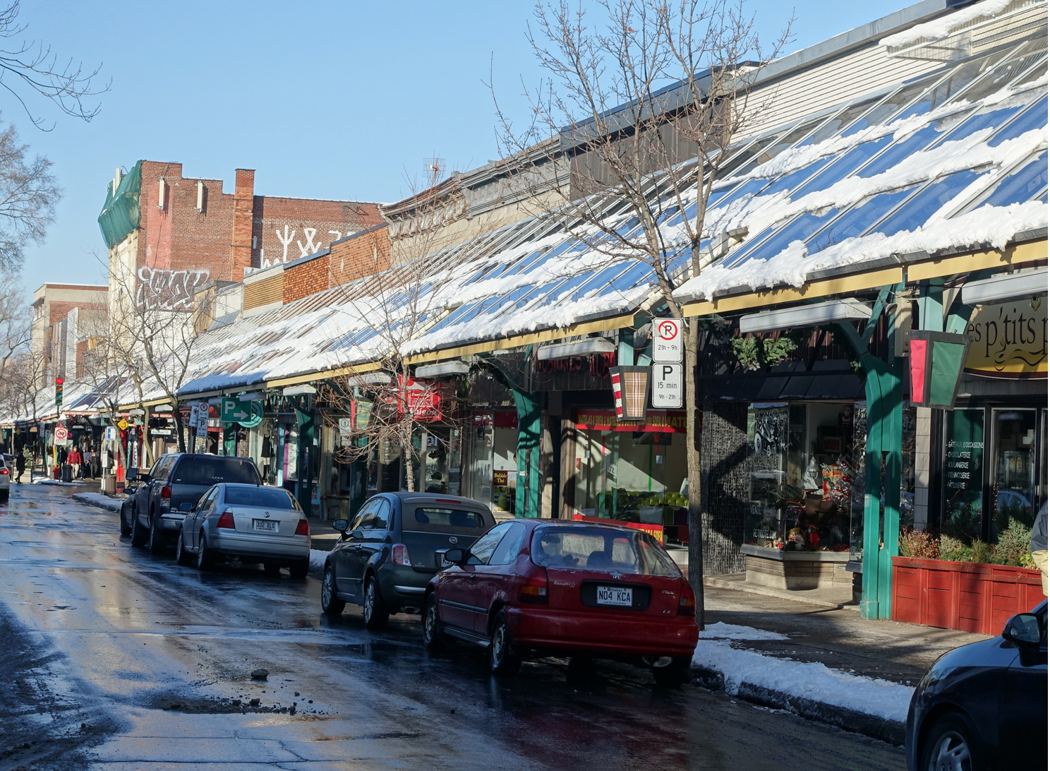 Rue St-Hubert is a five-block long street with over 400 mom and pop businesses - from thrift stores to wedding shops.  A canopy over the sidewalk, protect pedestrians from the elements and creates a unique sense of place.