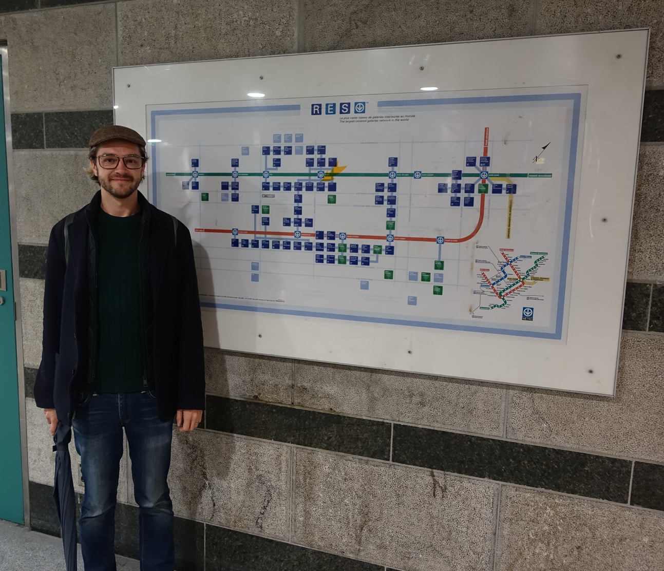 Tom standing beside one of the few Underground Maps showing all of the buildings that are linked by tunnels as well as to the METRO subway.