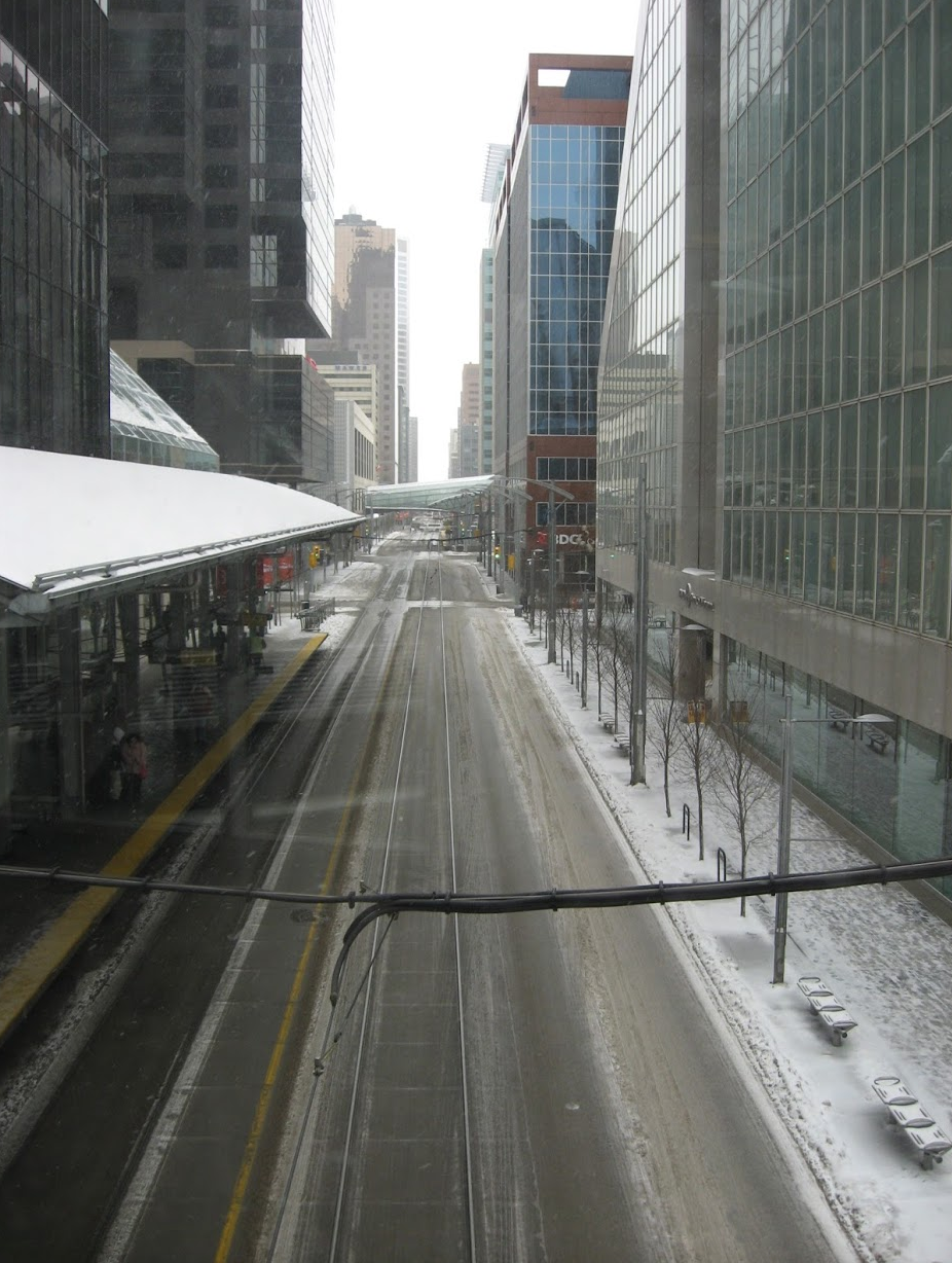 Look out at Calgary's 7th Avenue Transit Corridor from the +15 bridge linking The Core to First Canadian Centre.