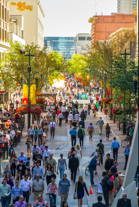 Calgary's Stephen Avenue Walk at noon hour is packed with people strolling the pedestrian mall. It is lined with shops, restaurants, vendors and patios.  (photo credit: Jeff Trost)