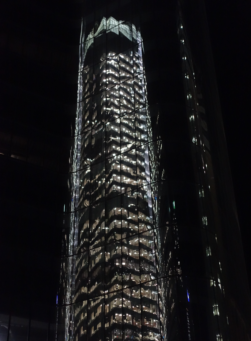 Downtown's glimmering and shimmering glass towers become jewel-like at night.