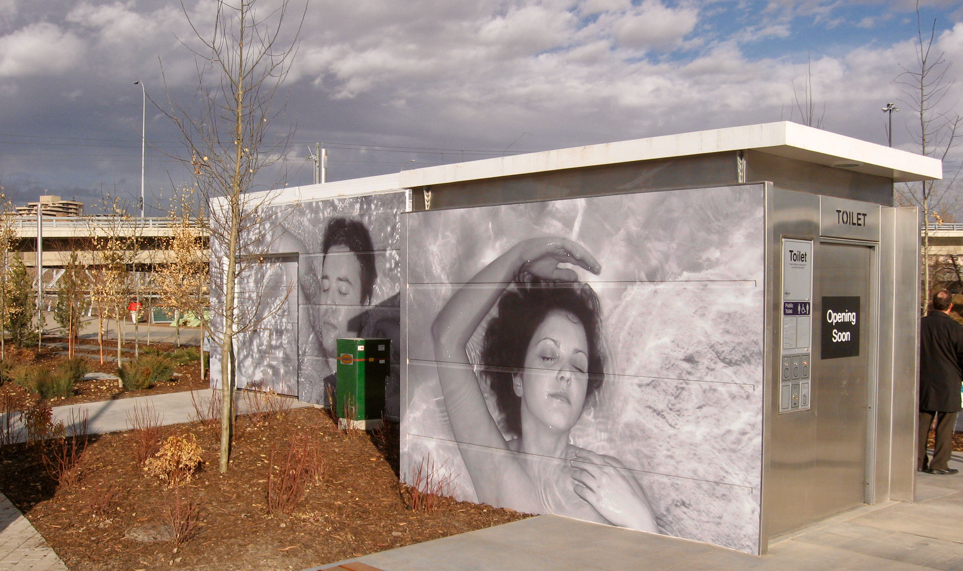 "Derek Besants, ""I am the river"" utilizes the facade of the public washrooms for his art."