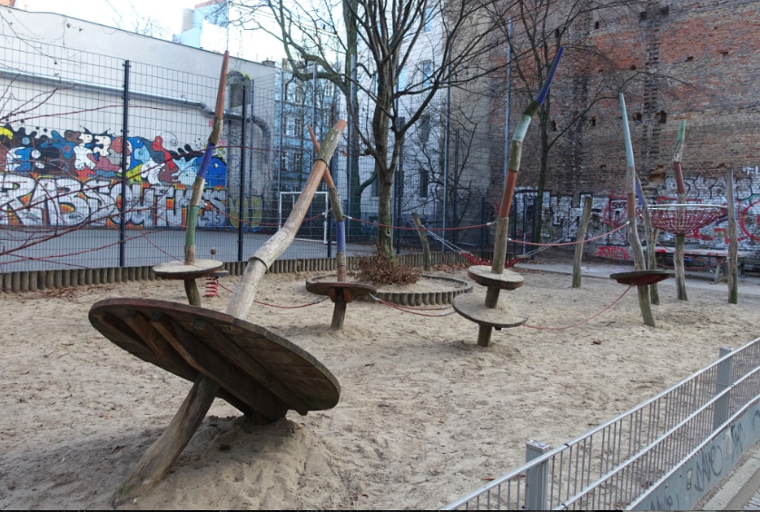 I told you the playgrounds were old school. These look like huge spinning tops.