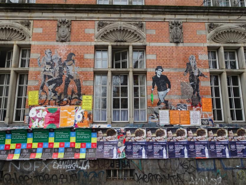 Graffiti meets poster art, meets street art on this building.