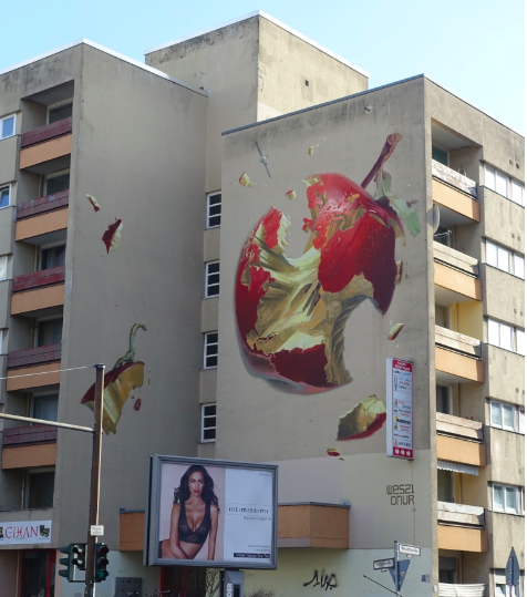 I am curious to know why this piece of street art is on this very ordinary apartment block.