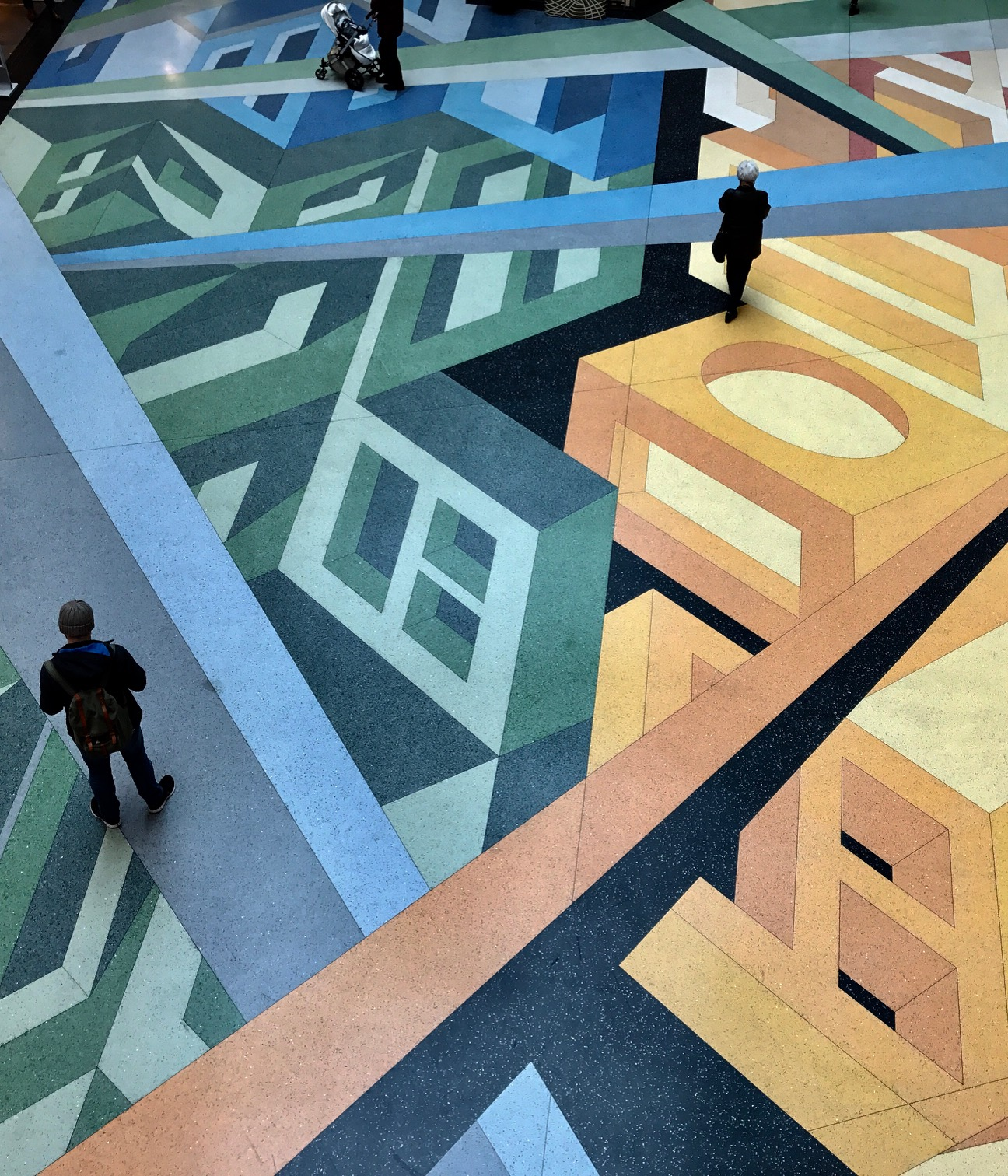 The floor of the Alexa shopping centre is a wonderful and colourful work of art that you get to walk on and see from above. How fun is this?