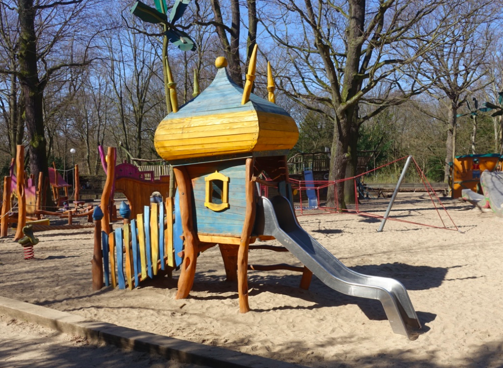This playground had fun theme, including a snake on a spring for rocking back and forth and other exotic shapes and characters.