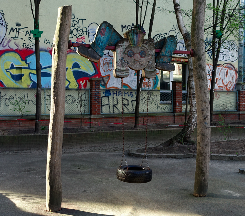 Almost all of the swings in Berlin have some sort of character at the top. In this case, it was a well-weathered cartoon figure, but in most cases it was an animal.