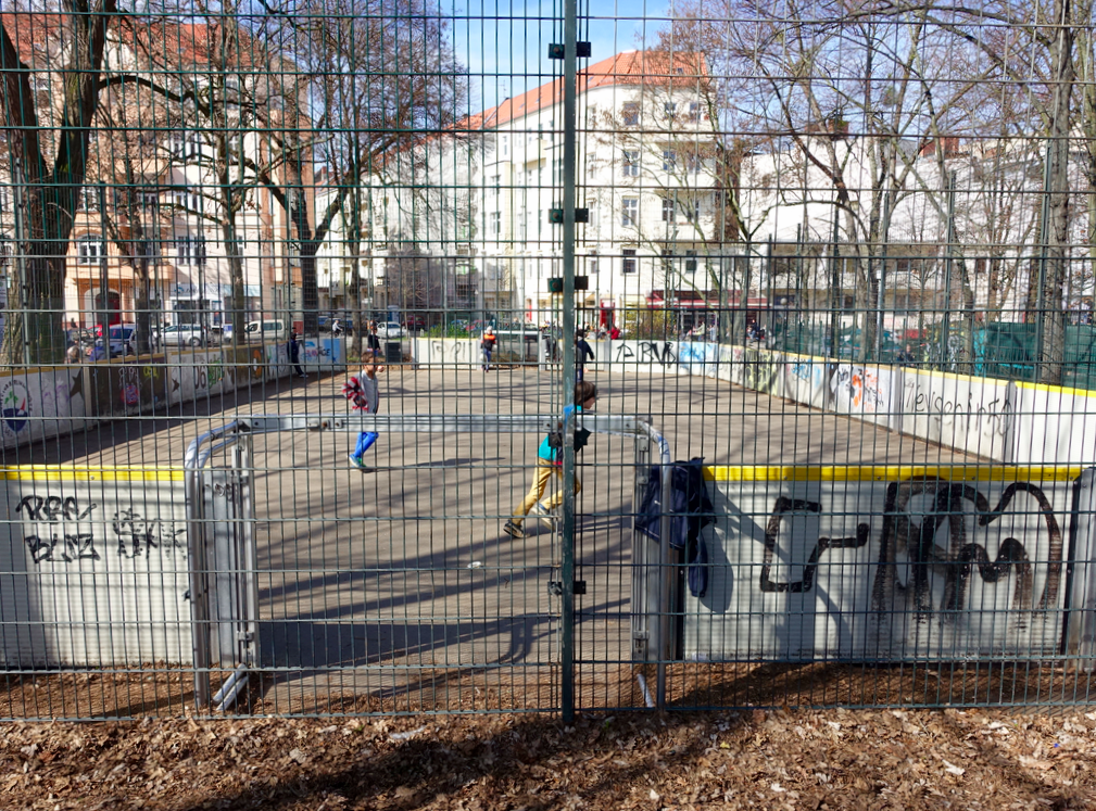 Another example of caged arena-like play area. Note it is typical for there to be lots of graffiti in and around the playgrounds, nobody seems to mind.