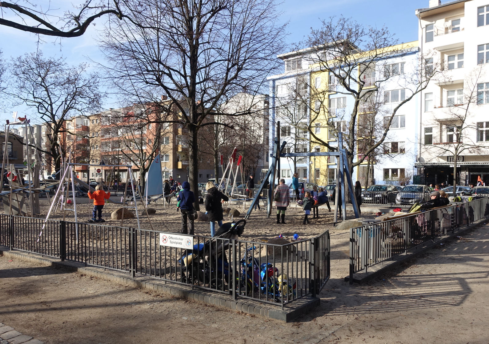 Instead of backyard, kids play in the local playground which is surrounded by mid-rise residential blocks.