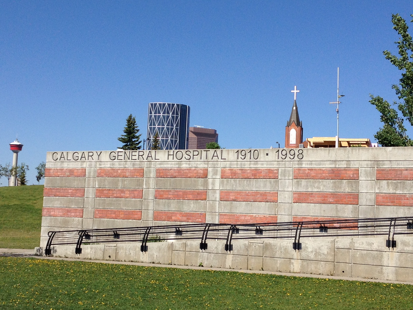 Monument to Calgary General Hospital with Calgary Tower in the background.