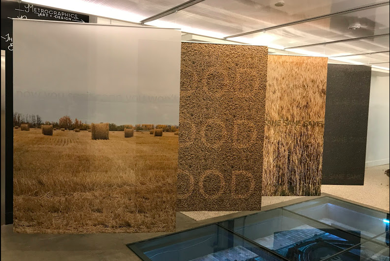 "John Freeman, Now You See It Soon You Won't, 2011, inkjet in on translucent polyester fabric. This tryptic that combines image word association ""Rye-Food,"" ""Grain-Same"" and ""Canola-Same"" with images of prairie agriculture."