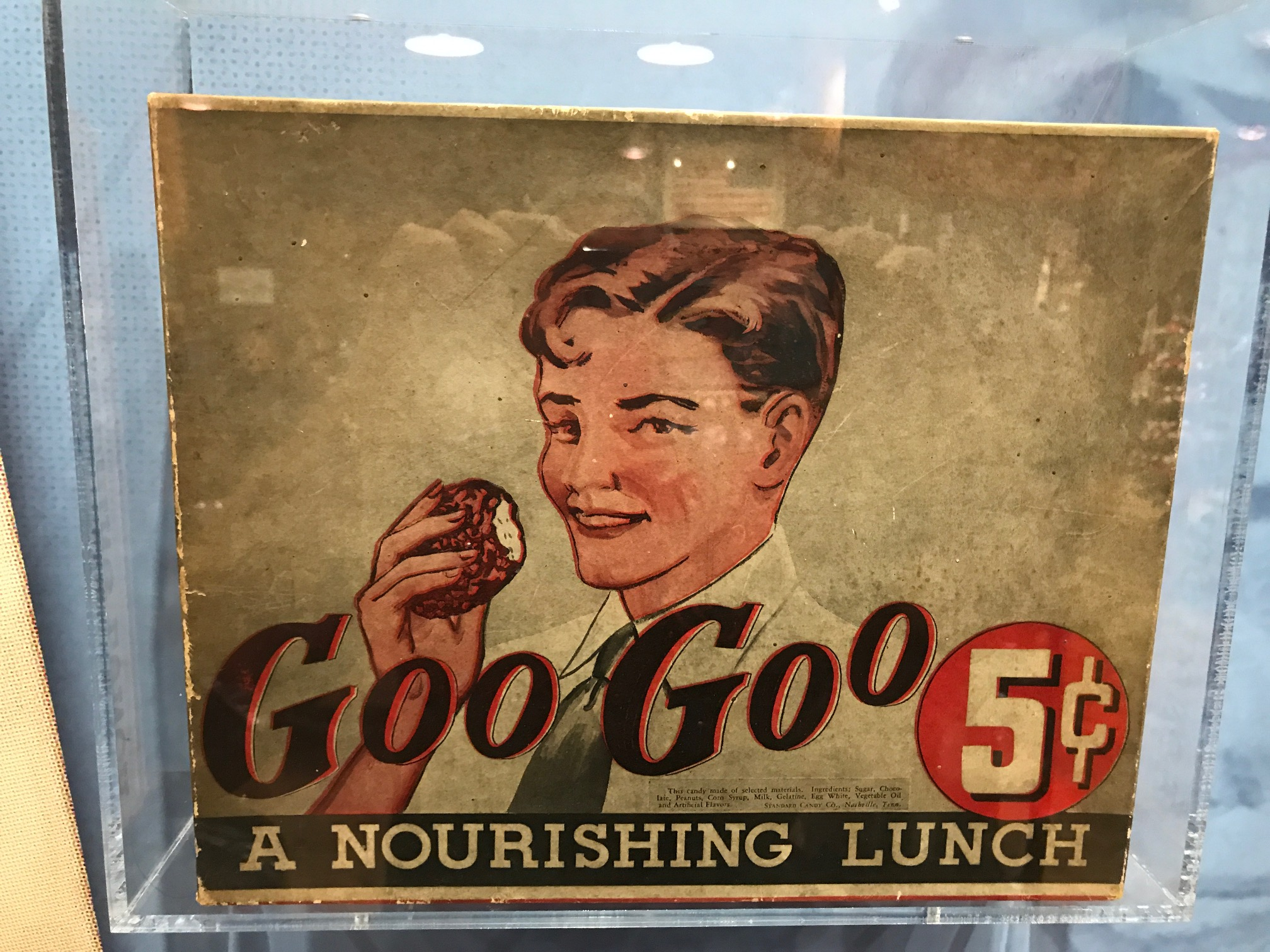 The GooGoo Cluster is an American candy bar created in 1912 by Howell Campbell and the Standard Candy Company in Nashville. The original disk-shaped candy bar contained marshmellow, nougat, carmel and roasted peanuts covered in milk chocolate.  And, yes it was marketed as nourishing lunch treat.