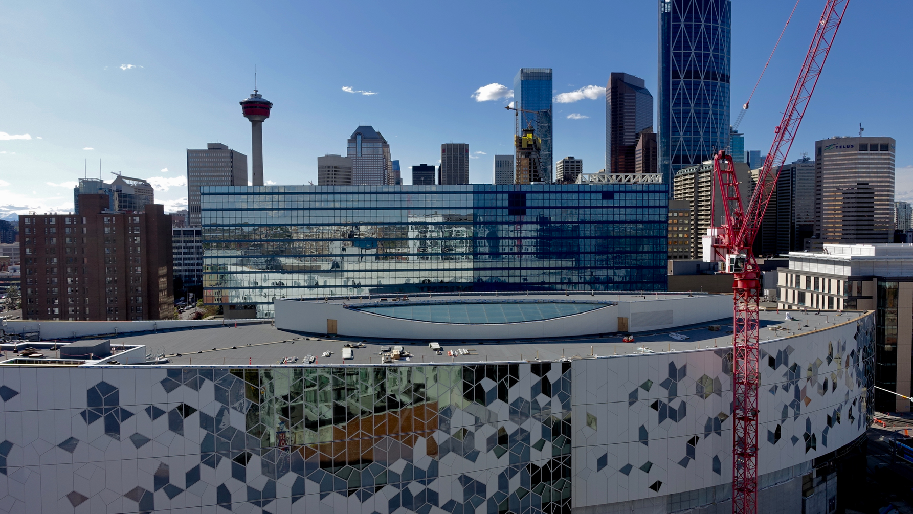 A view of Calgary skyline from the N3 condo rooftop patio with the new Central Library in the foreground.