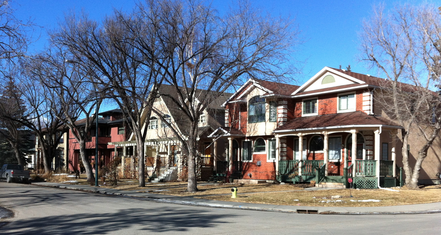 This street in Parkdale is on the block immediately west of the one above. It is lined with new infills that illustrate the diversity of infill designs that can be found in Calgary.