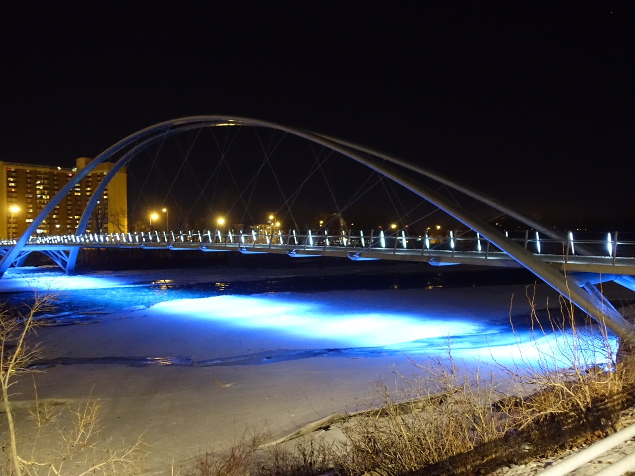 George C. King Bridge over the Bow River connects East Village to St. Patrick's Island and Memorial Drive.