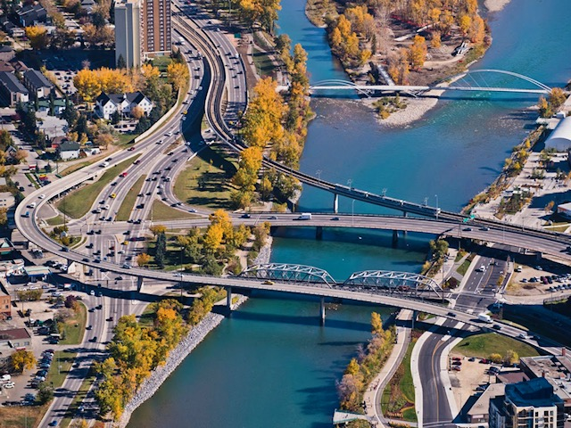 There are five bridges at the east end of downtown over the Bow River. (photo credit:  Peak Aerials)