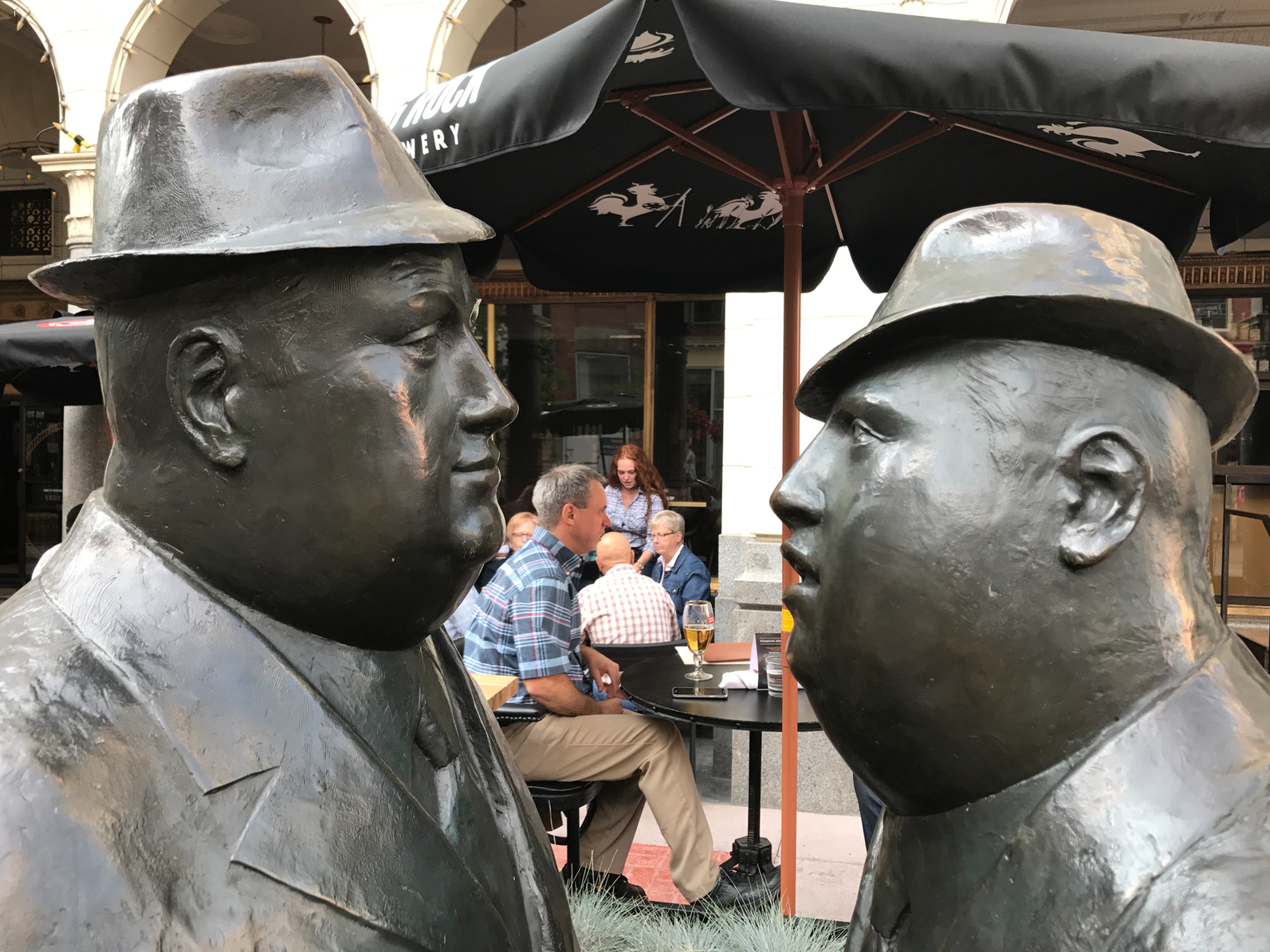 The Conversation by William McElcheran, on Stephen Avenue Walk in downtown Calgary is Calgary's signature piece of public art. It epitomizes the importance of Calgary's downtown as one of North America's leading corporate headquarter centers.