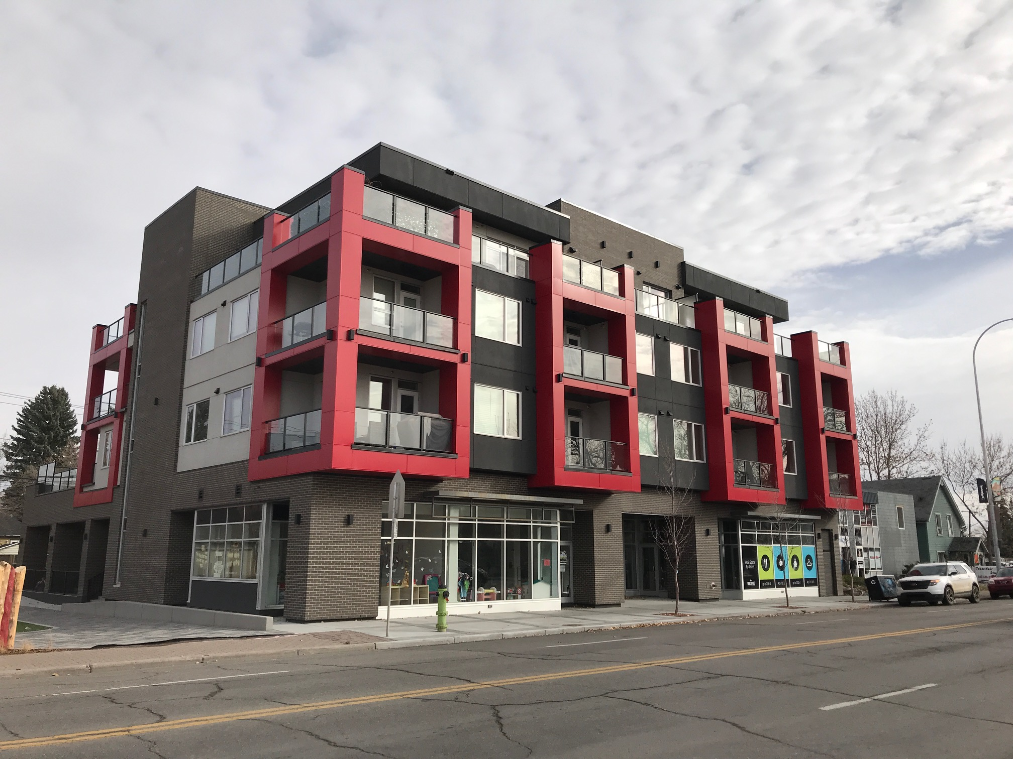 The I.D. Inglewood condo by Sarina Homes completed in 2016 at the east end of 9th Avenue SE, features three-storey high red balcony boxes that recall the red ladder of the Orange Lofts and perhaps the Alberta Children's Hospital windows.