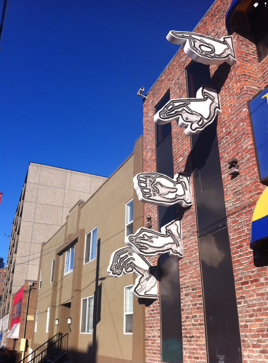 Hand Signals is a fun piece of public art by Derek Besant. It spells out the word DREAM. You will find it on 4th Avenue between 14th and 15th St SW.
