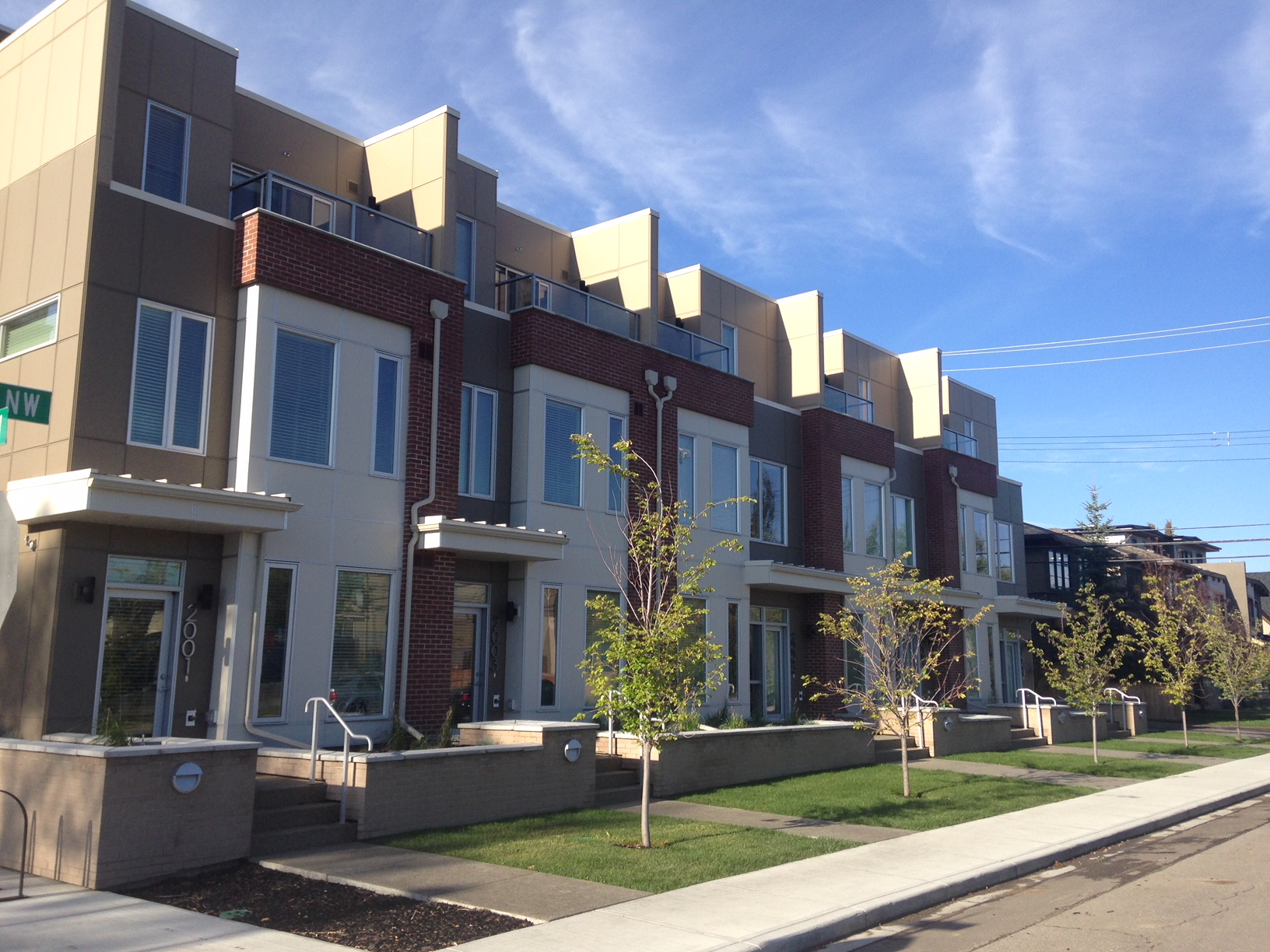 Townhomes at the base of mid and highrise condos create a transition from low to mid density.