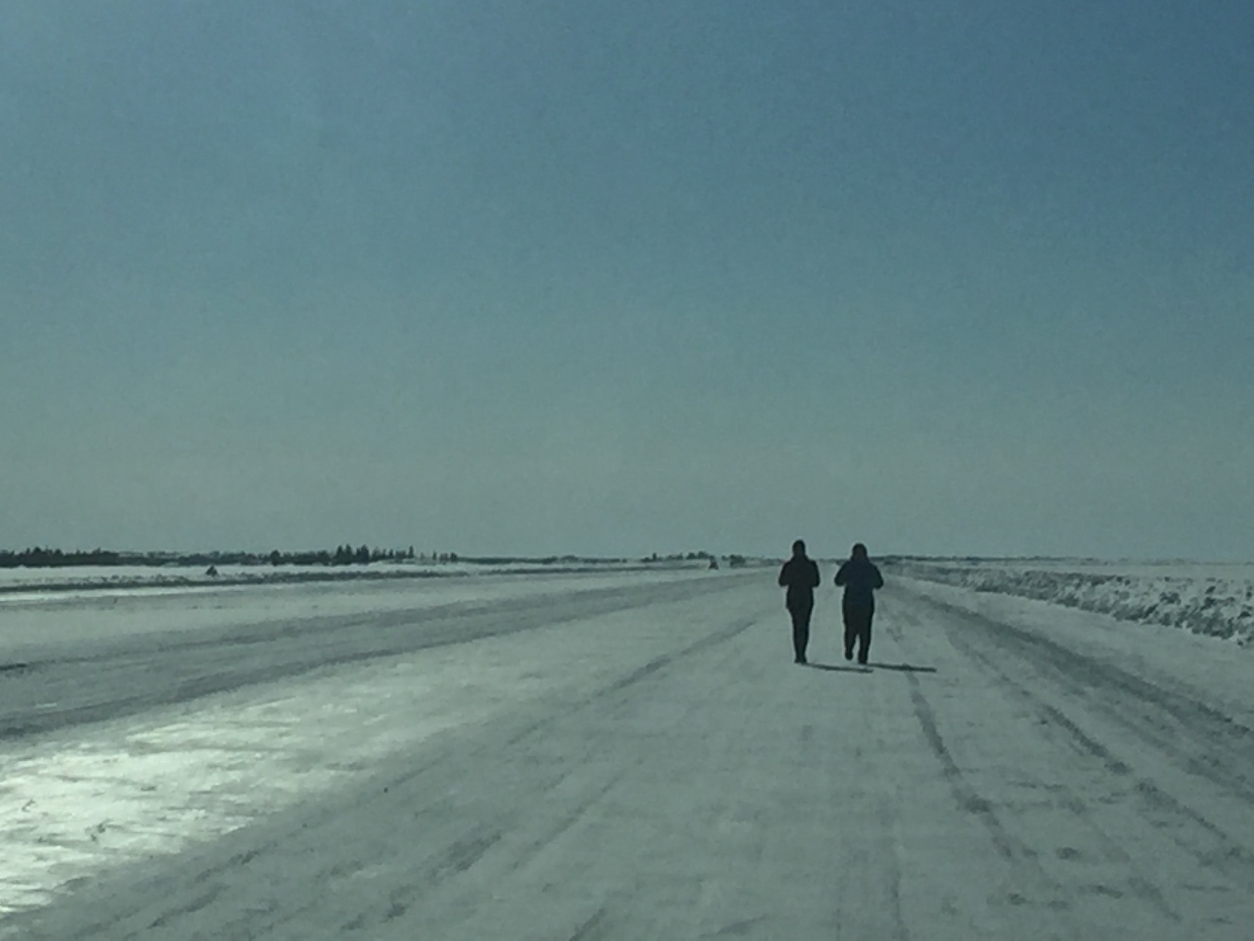 Joggers on the ice highway.