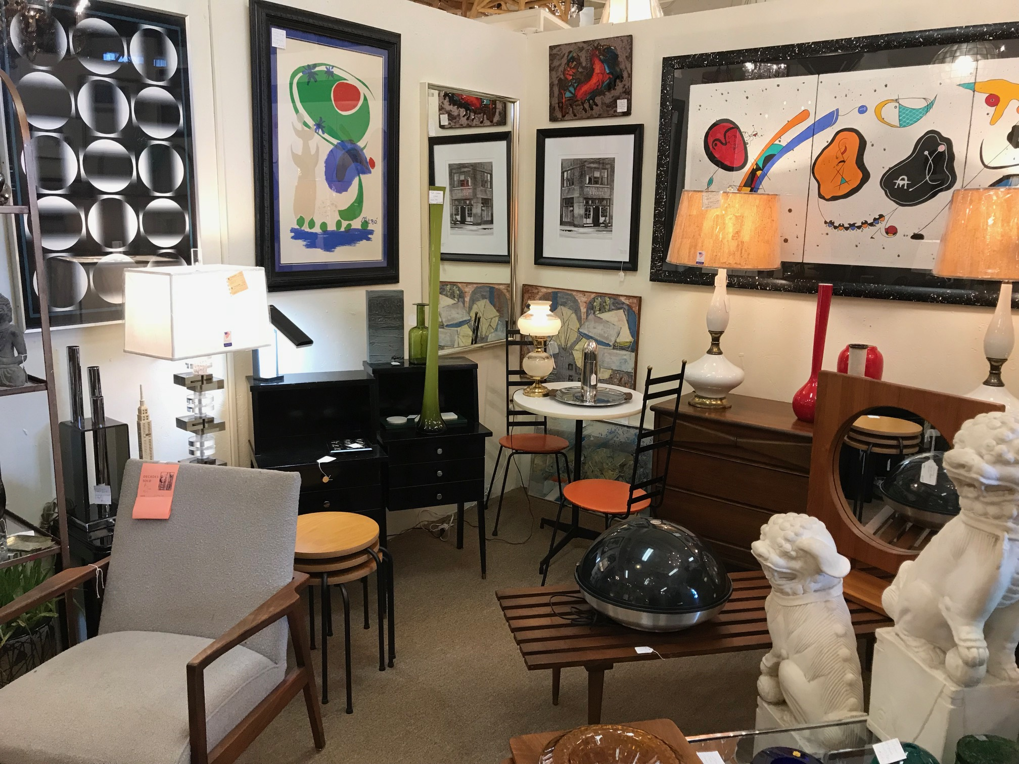 If you are looking for curated funky mid-century modern furnishings and artwork you have to go to   Decades Antiques and Vintage   at 1886 Cheshire Bridge Rd NE.  There are several antique and thriftstores in the area.