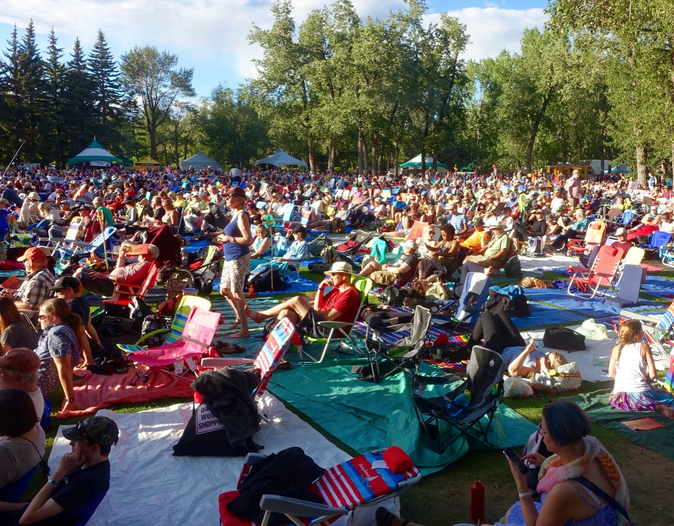 "Calgary's Prince's Island Park is transformed into a huge ""love-in"" during the Calgary International Folk Festival."
