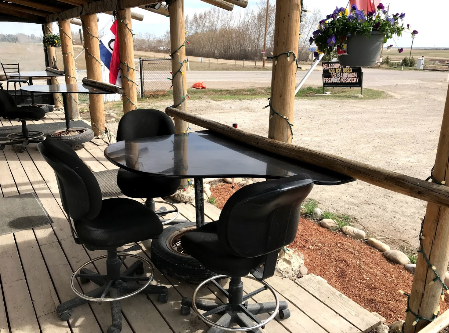 The porch has these lovely tables for anyone wanting to sit and have a coffee or perhaps a Coke and sandwich and enjoy the big prairie sky.