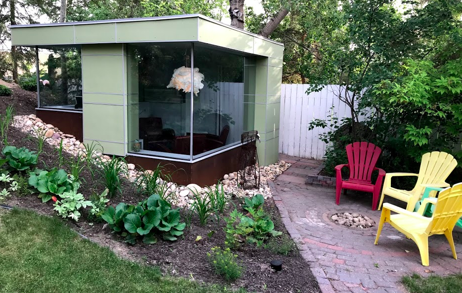 Backstory: This and the next photo are from the backyard of an architect friend in Saskatoon. I am so jealous of his man cave.  Since I could never have my own garden pavilion, I got him to take me to his birdhouse maker so I could get one of the birdhouses.  I loved them so much I got two.