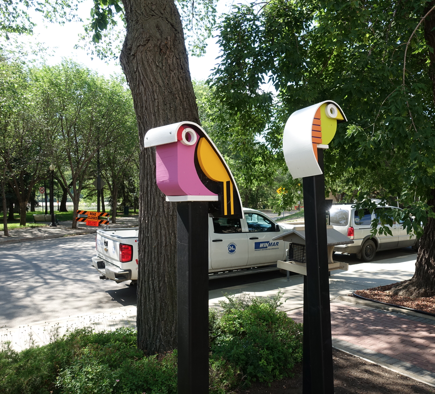You will find these two colourful birdhouses outside of JR's birdhouse workshop at the corner of Spadina Cr. and 20th St. E.
