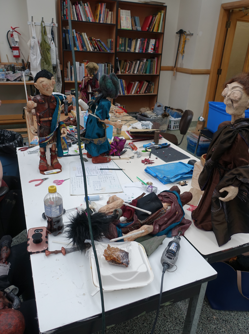 Puppets in various stages of completion.