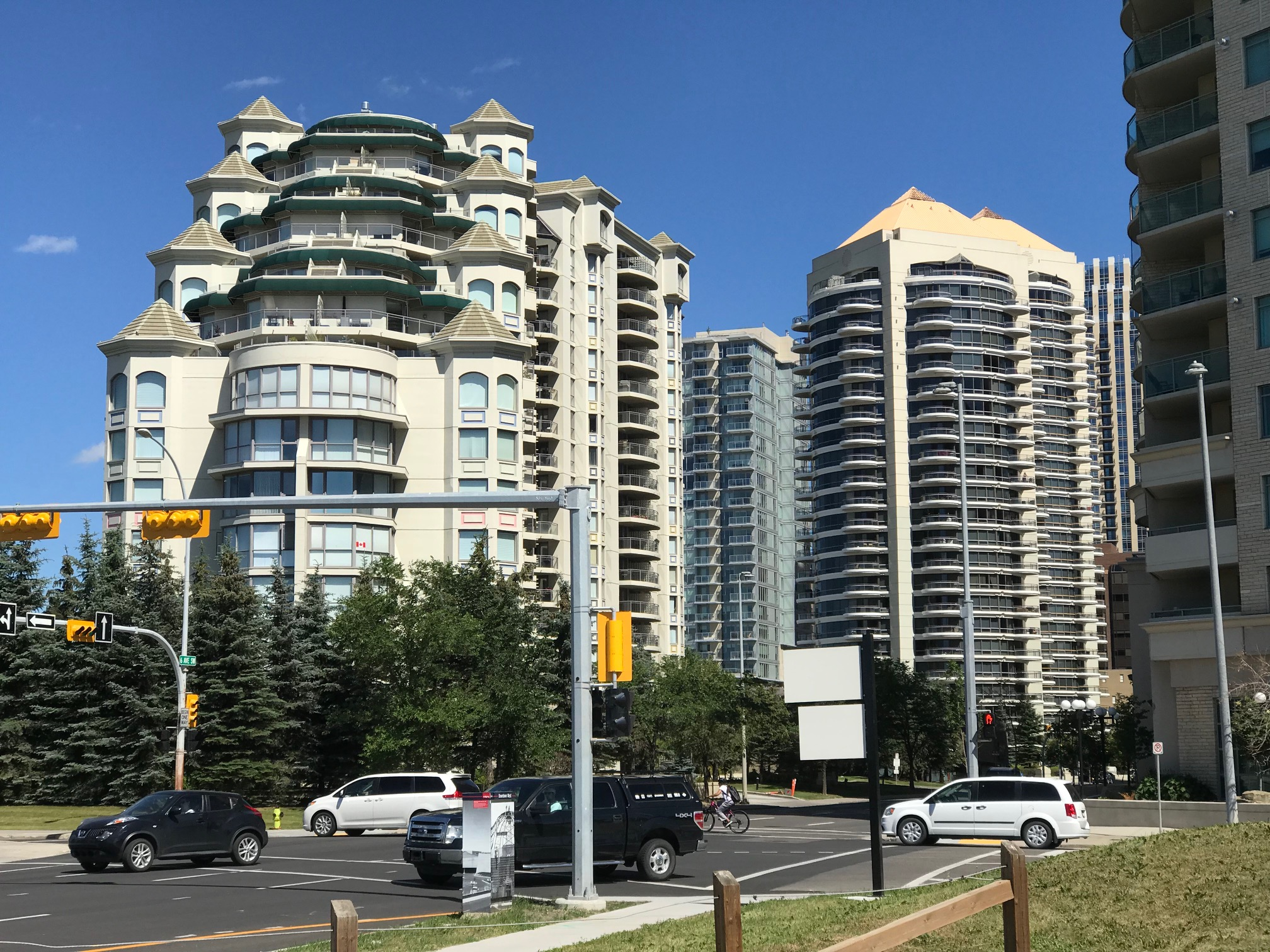 Late 20th century residential development in West Downtown neighbourhood is located on the edge of  Bow River Promenade.