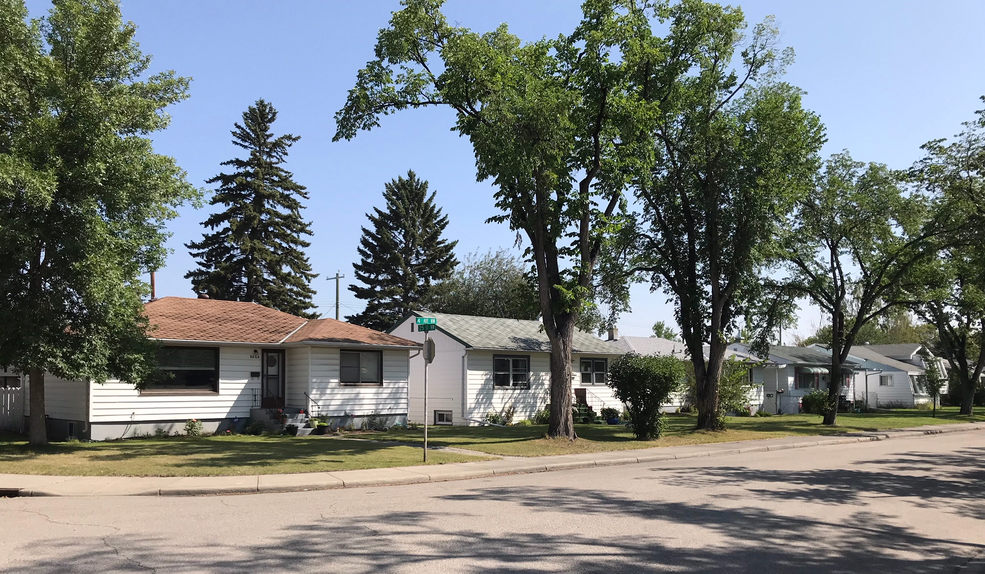 Typical '50s or '60s street with single family, single story homes are large lots. While many once housed 6+ people today they are home for one maybe two people.