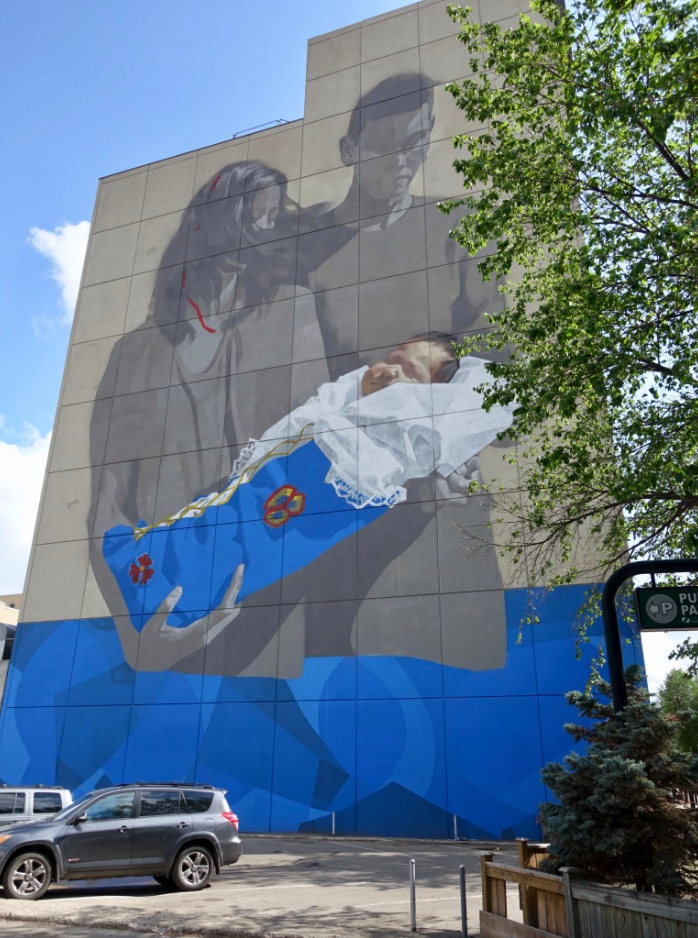 13-storey mural on the side of the First Nation's Bank of Canada by artist Emmanuel Jarus is one of the best murals I have seen this year. It is well executed, the subject matter is appropriate for the site and it is monumental which is what murals should be. To me it is heroic!
