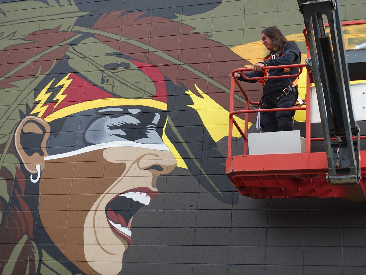"Kalum Teke Dan's mural in progress on the side of 17th Ave Framing. It is intended to ""develop understanding and foster reconciliation between indigenous and non-indigenous peoples."""
