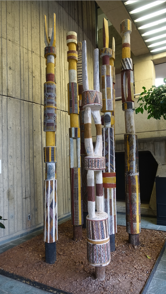 Inside Dal's Art Centre we found these stately aboriginal sticks from Australia  was tucked behind the staircase.