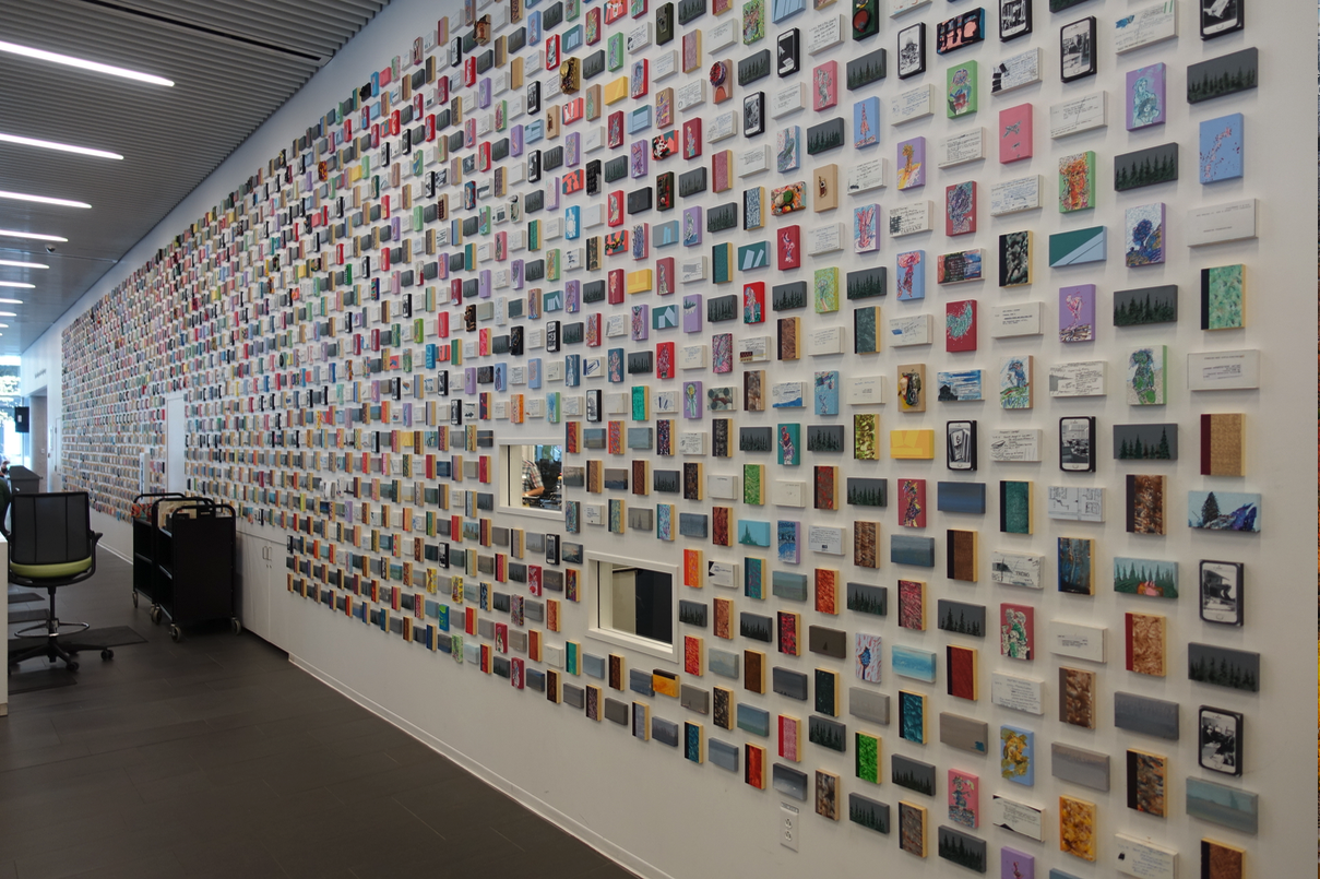 "Cliff Eyland's huge mural titled ""Library Cards"" located in the lobby of the Halifax Central Library consists of hundreds of small artworks the size of a library card. The paintings cover a spectrum of subjects and styles that are fun to look at. There is even a window in the middle where you get a glimpse of librarians working behind the wall.      Eyland has a similar piece in the lobby of the Winnipeg's Central Library that is 24 ft by 28 ft. In order to see the pieces at top binoculars are available to borrow, or you can bring your own."