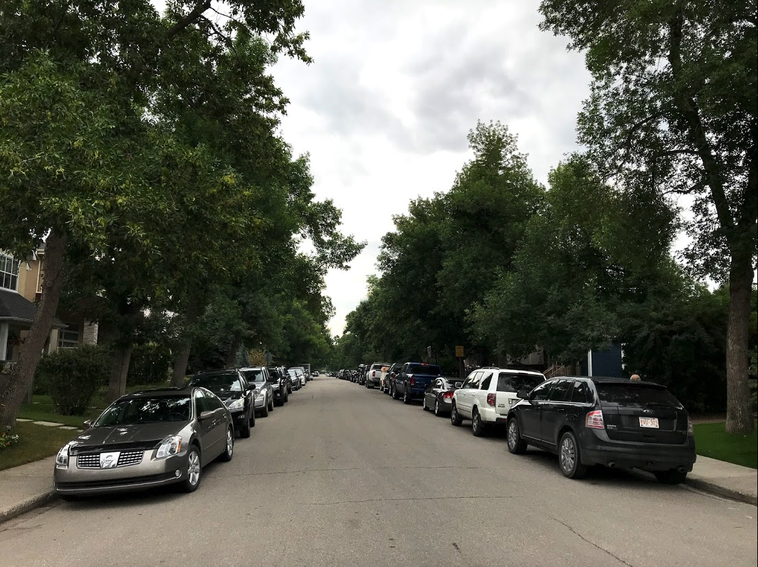 A typical inner city street in Calgary is lined with cars evenings and weekends even though every house has a garage or parking pad in the back alley.