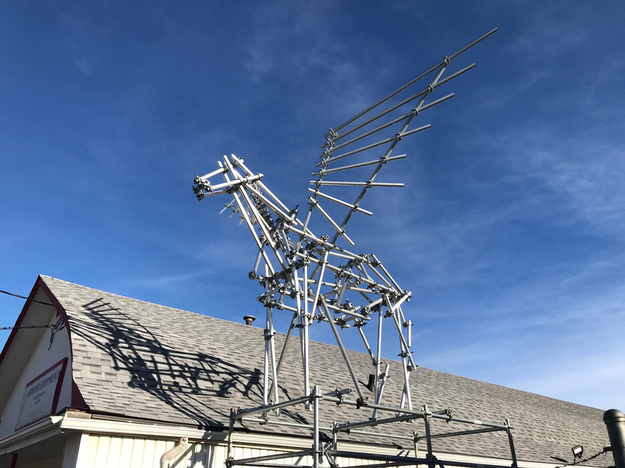 "I had to smile when I found this Pegasus figure in the yard of a scaffolding warehouse in Calgary's Manchester community. How clever? Is this public art? I say ""Yes!"""