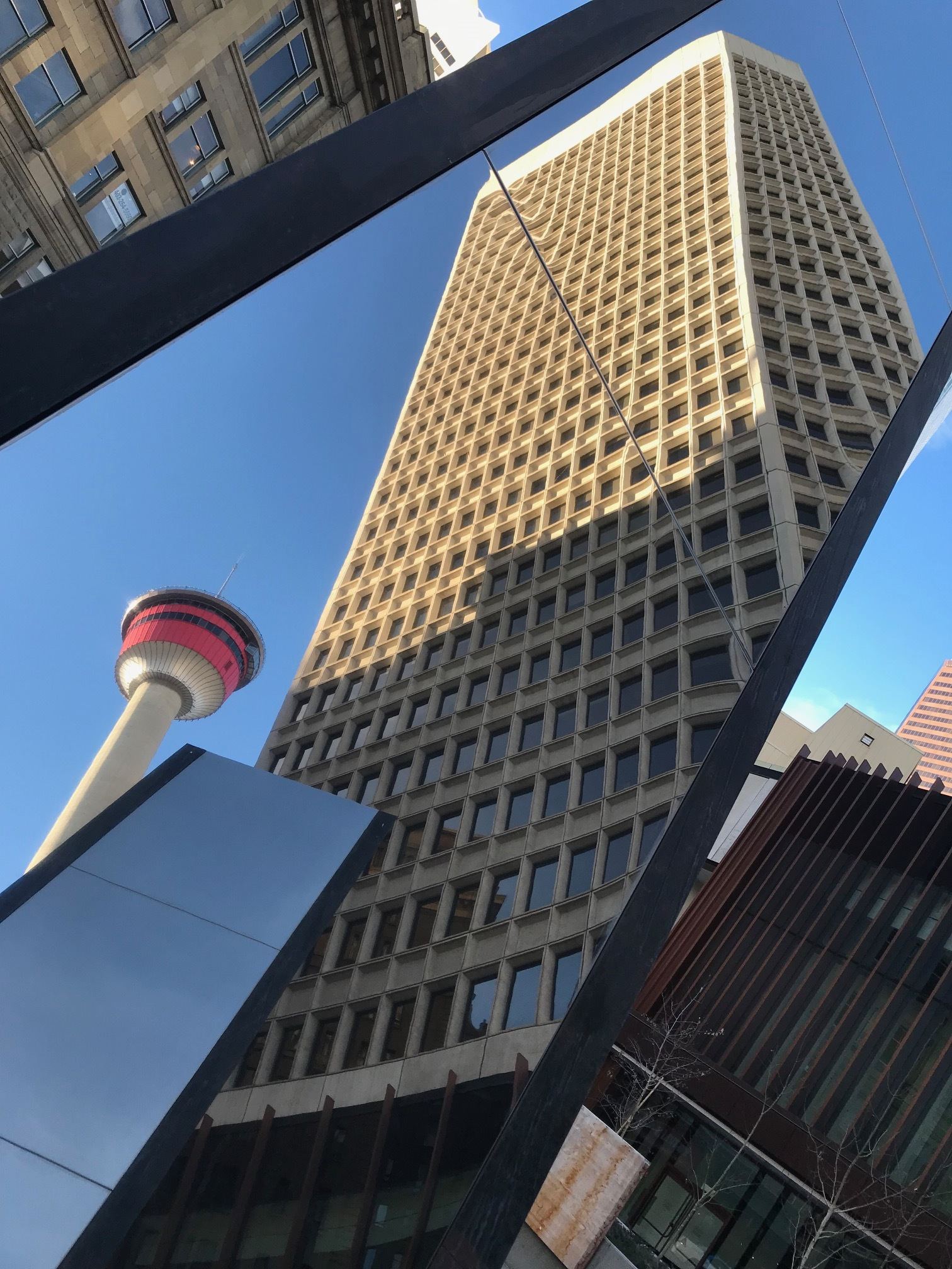 I love the interplay of the Calgary Tower with neighbouring urban design elements.