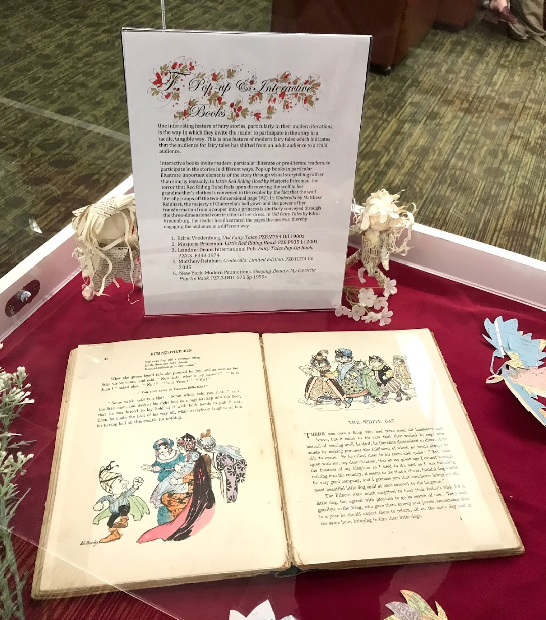 Each of the display cases had a text panel and then several books relating to the theme described in the panel. The displays also included hand painted red and gold colouring with origami like flowers and figures created by Dr. Kathie Shoemaker the exhibition supervisor.