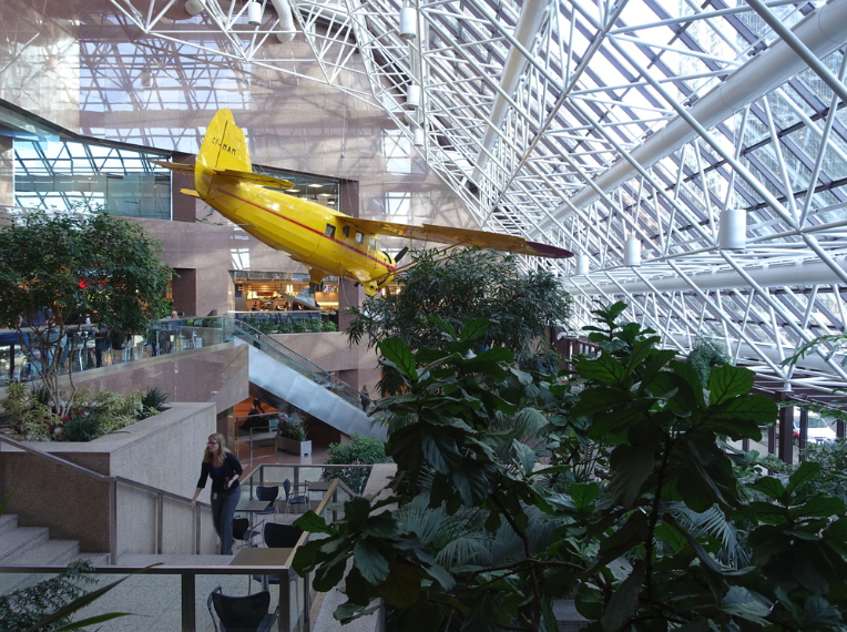Bush Plane hanging from the ceiling of the Suncor Centre office tower lobby.