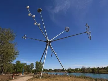 "Speaking of street lights, this public art work on St. Patricks' Island title ""Bloom"" by Michel de Broin, that incorporates vintage street lampposts welded to tripod is also as much an engineering feat, as an artist's statement."